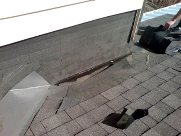Dead Valley - A dead valley will cause a leaky roof, water stains on your ceiling, and/or considerable ice build up. If you suspect you have a dead valley, contact Bricor Roofing today!